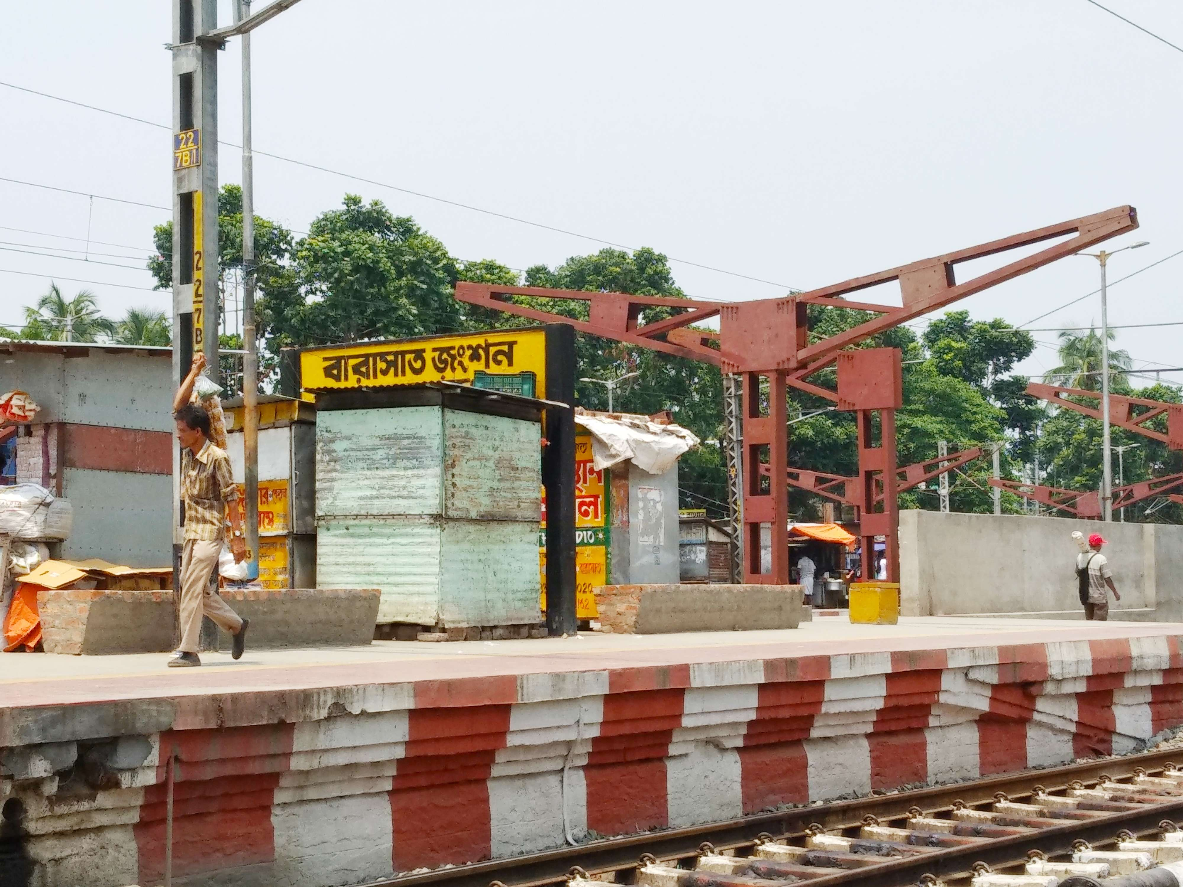 Station name almost covered by shop - Times of India