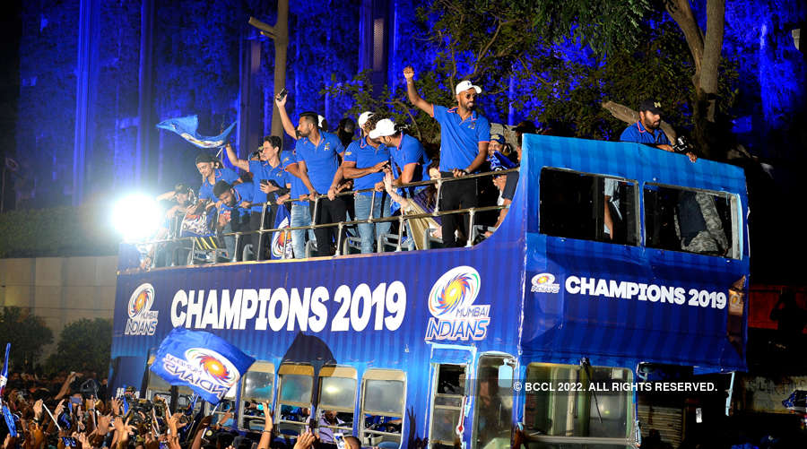 Mumbai Indians celebrate victory with fans in open-bus parade