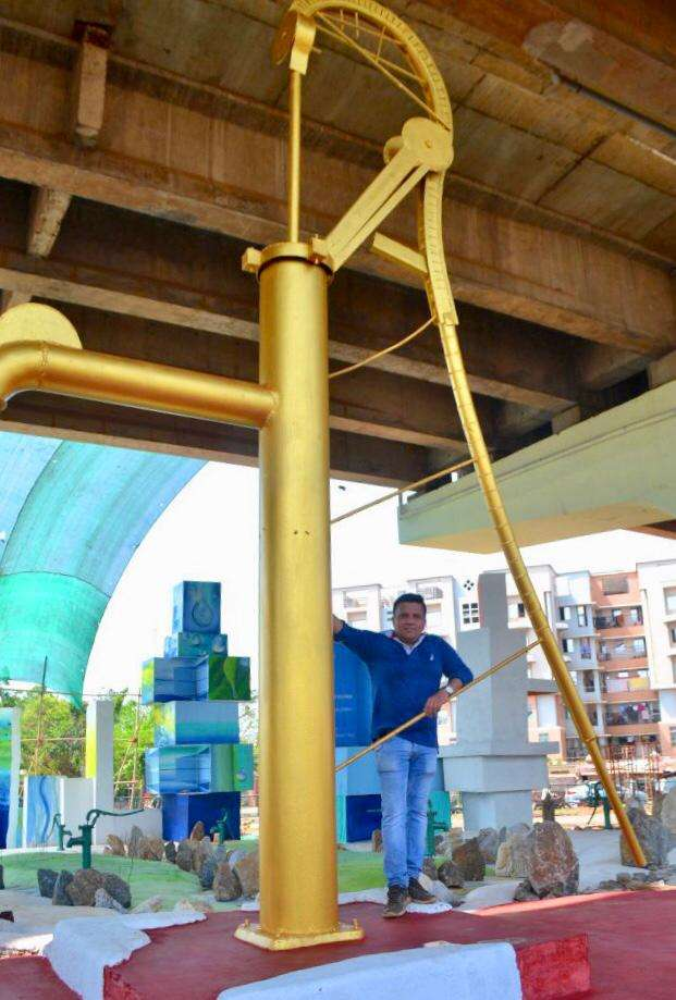 1-Manav Gupta with the giant tubewell instalation at Rasulgarh Square.