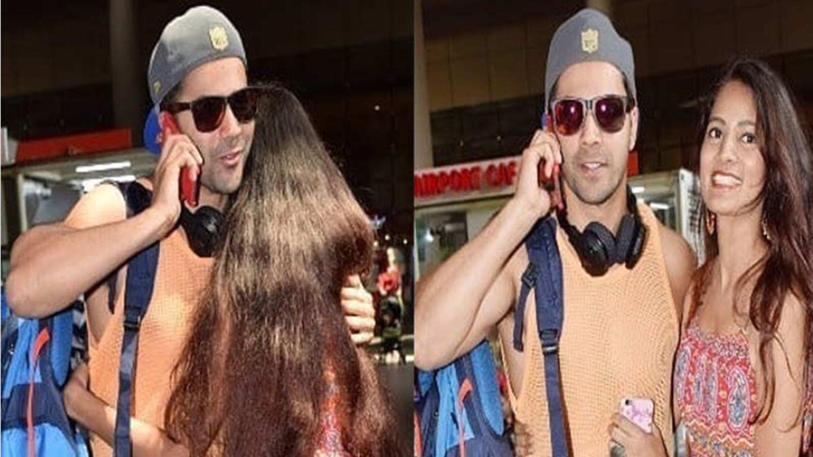 Female fan jumps out of nowhere and hugs Varun Dhawan, actor caught by surprise