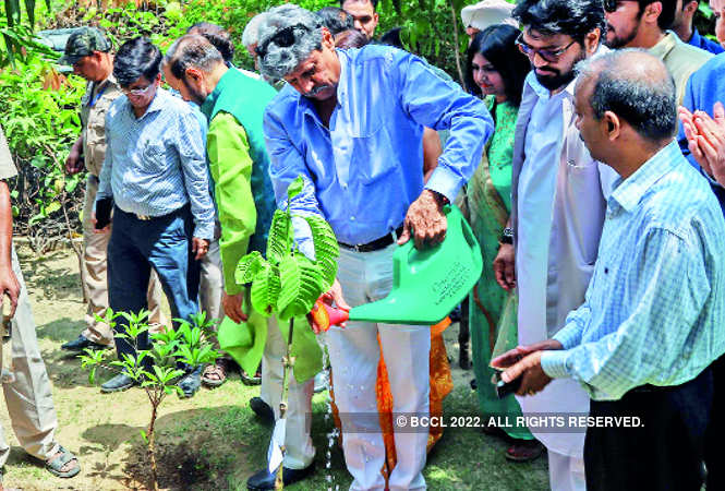 Kapil Dev waters plants at the event