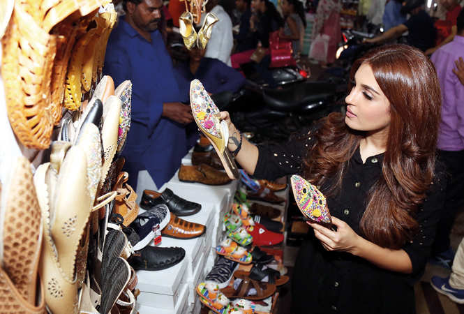 Which jooti is better, ponders Shiny Doshi at a shop in Nazirabad (BCCL/ Aditya Yadav)
