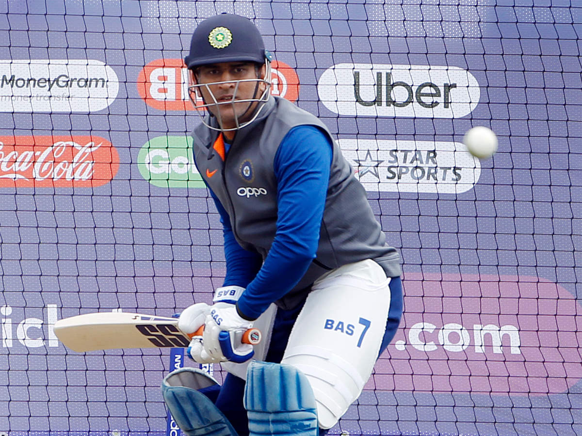 MS Dhoni trains with team following glove controversy