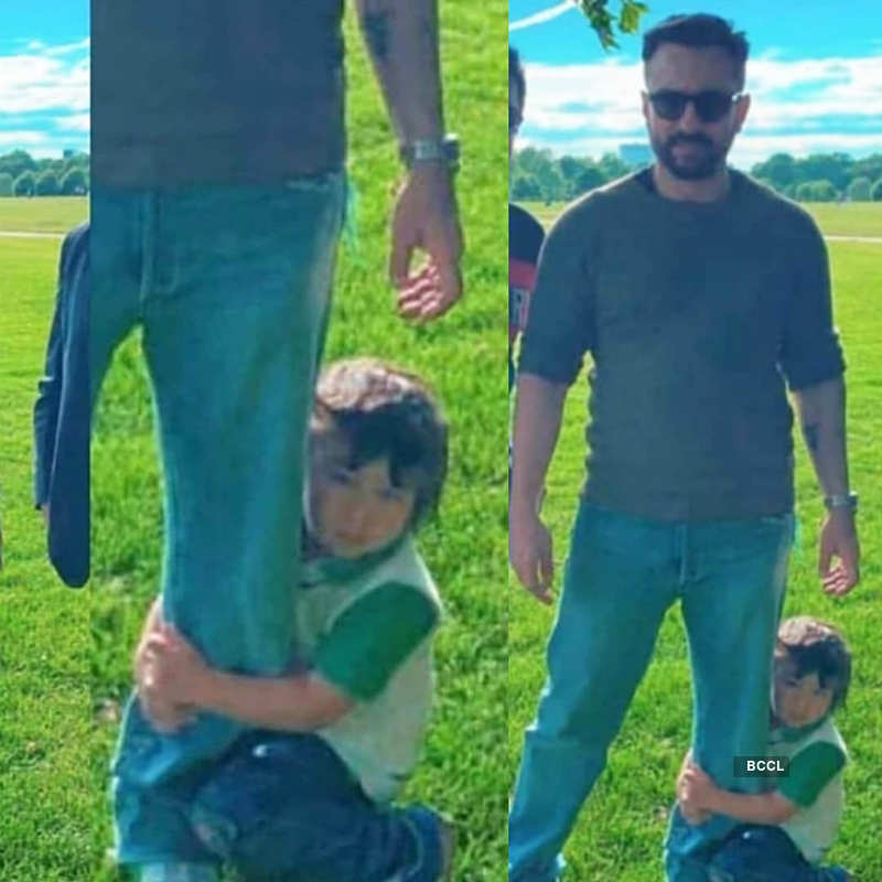 This picture of Saif Ali Khan all set to chop son Taimur's long, shaggy hair will make you smile