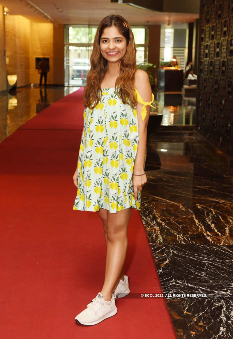 Ladies step out in style to attend a fashion exhibition