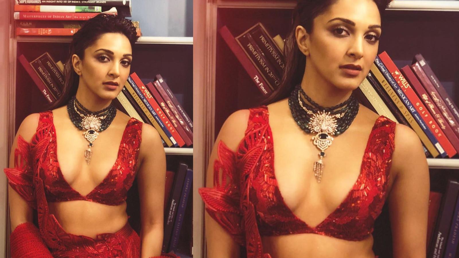 Kiara Advani looks gorgeous in red plunging neckline dress as she walks the ramp