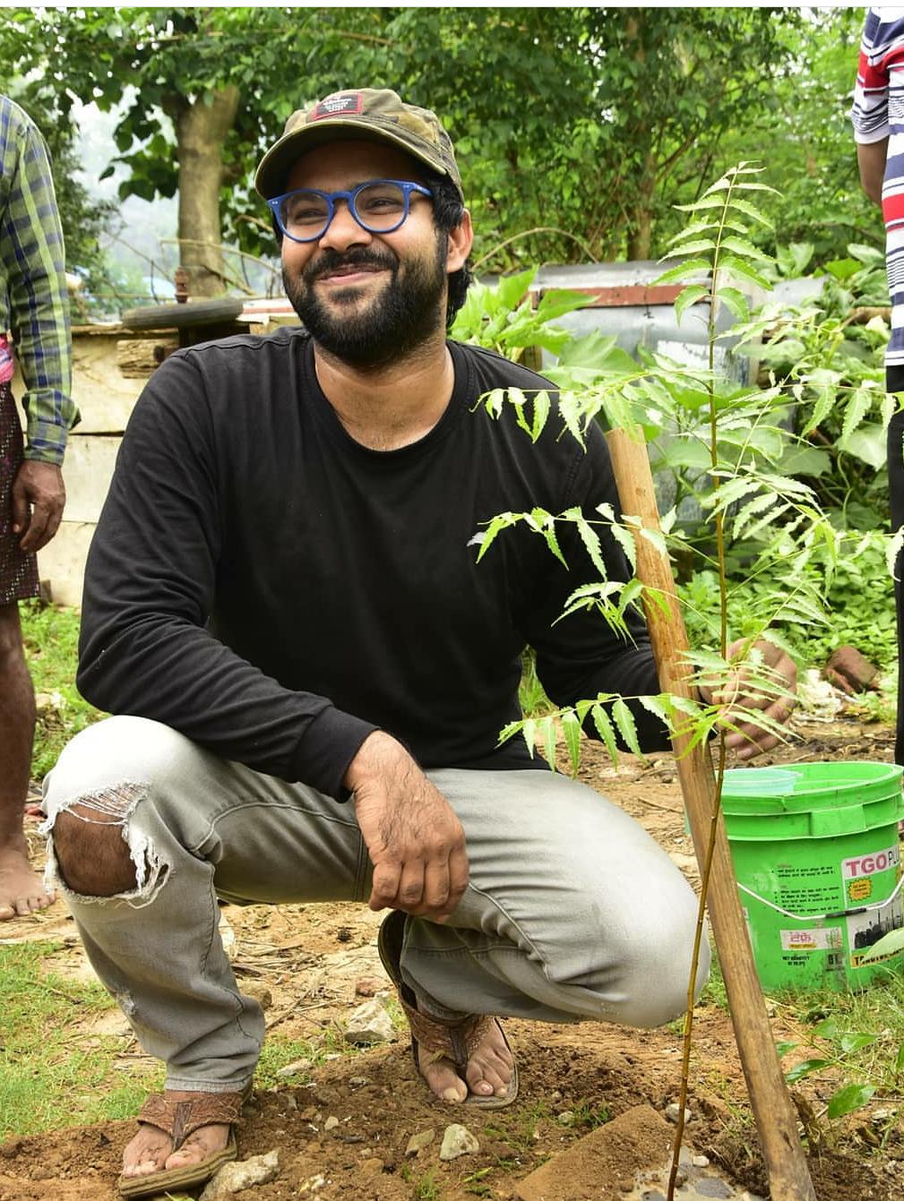 Sabyasachi Mishra plantating a tree