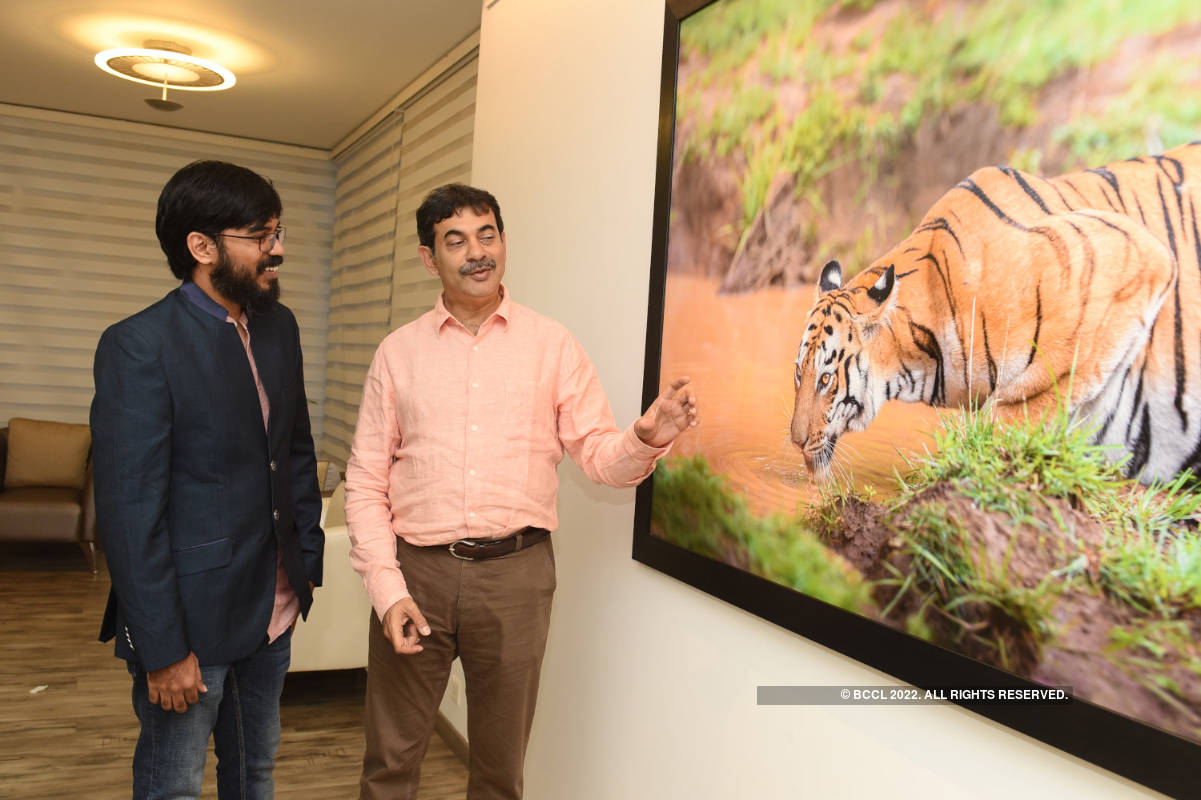 Wildlife photography enthusiasts attend a Tiger photo exhibition