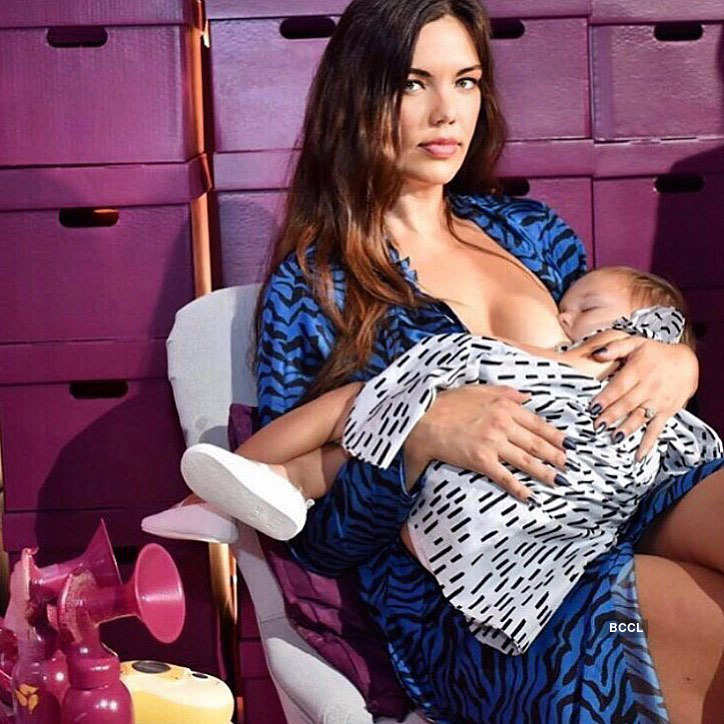 Model Mara Martin breastfeeds her child during the NYFW show