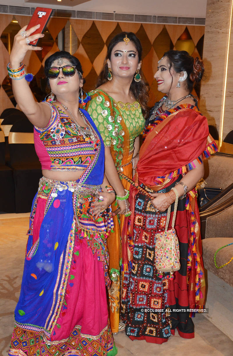 Ladies step out in style to attend a dandiya night