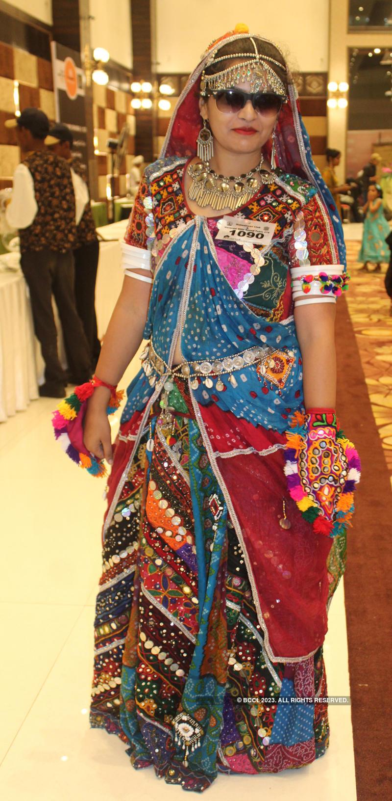 Banarasis enjoy at a rain dance dandiya party
