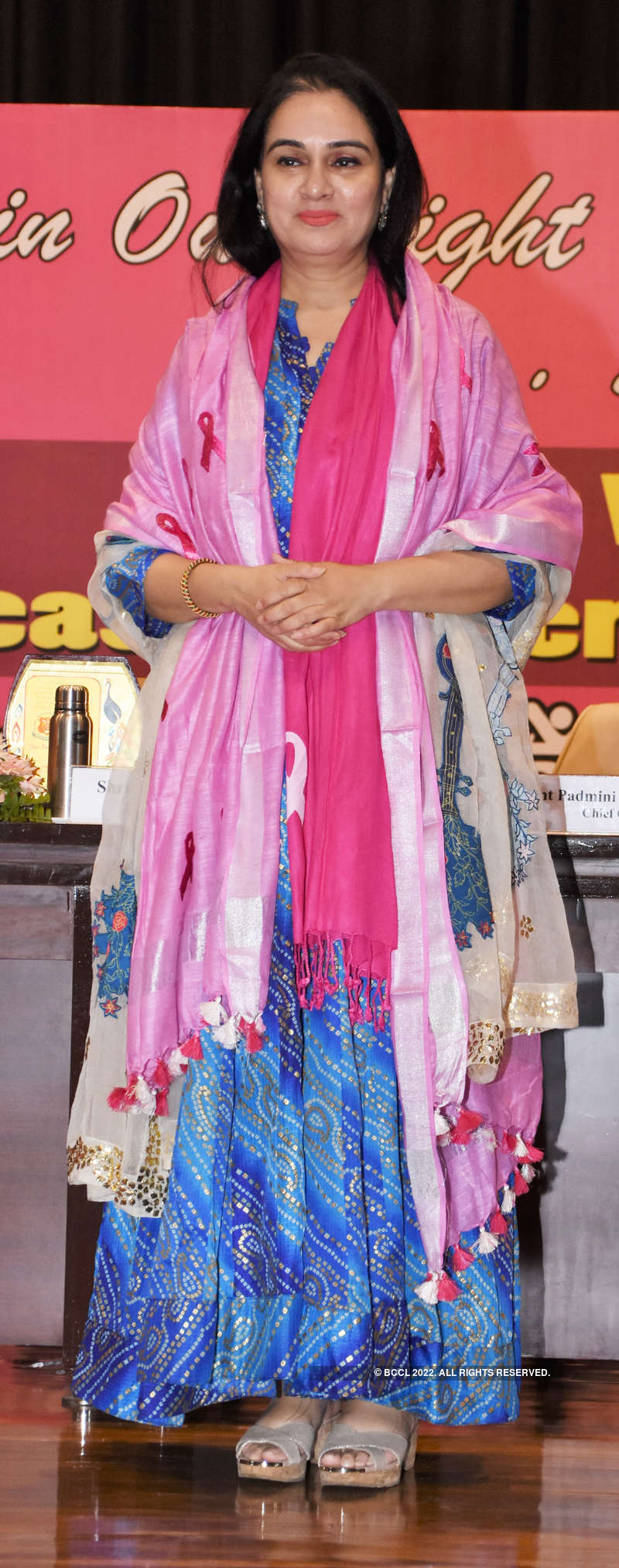 Breast cancer survivors walk the ramp at an event