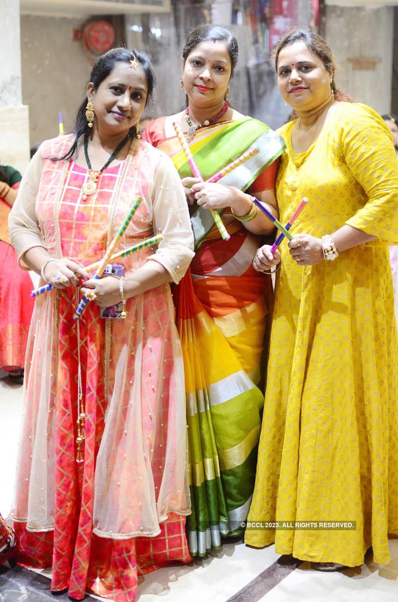 Ladies enjoy at a dandiya party