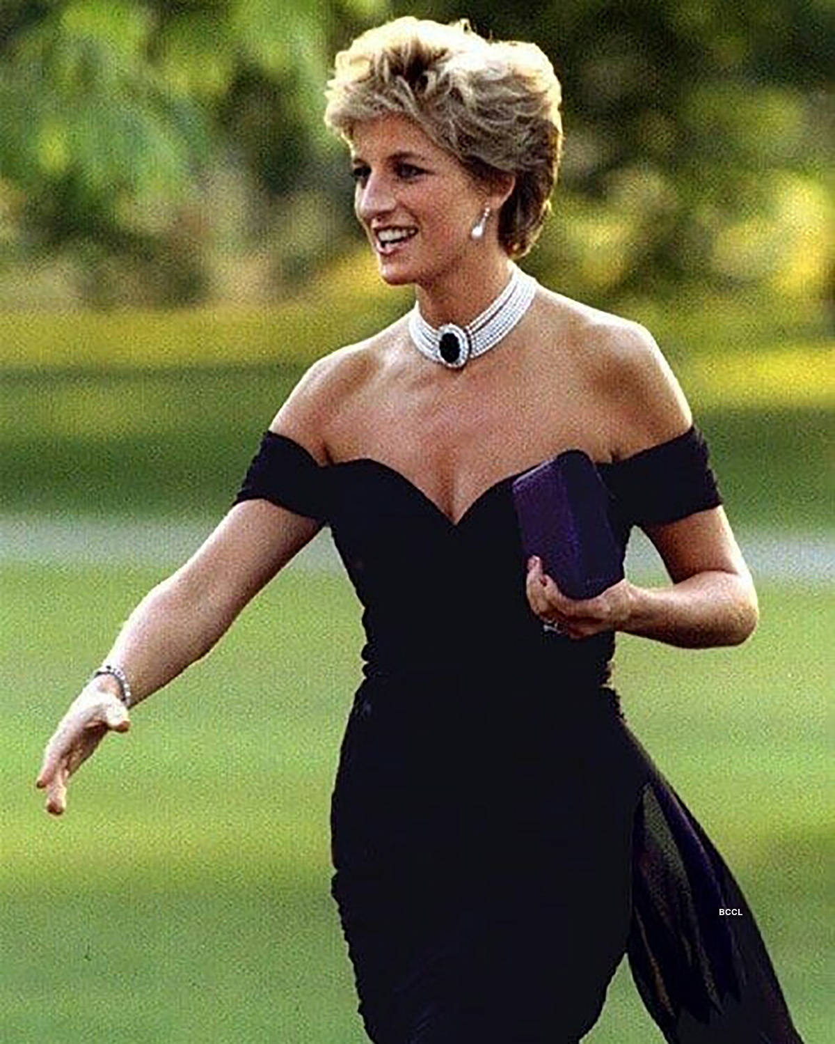 Princess Diana's iconic blue velvet evening gown that she wore to dance with Travolta is now up for auction
