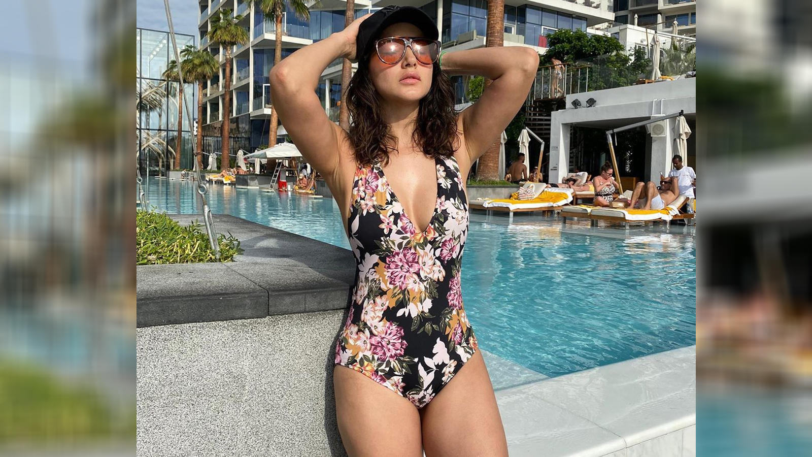 Hotness Alert! Sunny Leone sizzles in a floral swimwear, shares a picture from her Dubai vacation