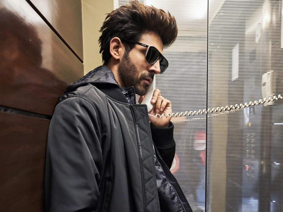 Photo: Kartik Aaryan asks fans to guess who he is calling - 'Patni ...