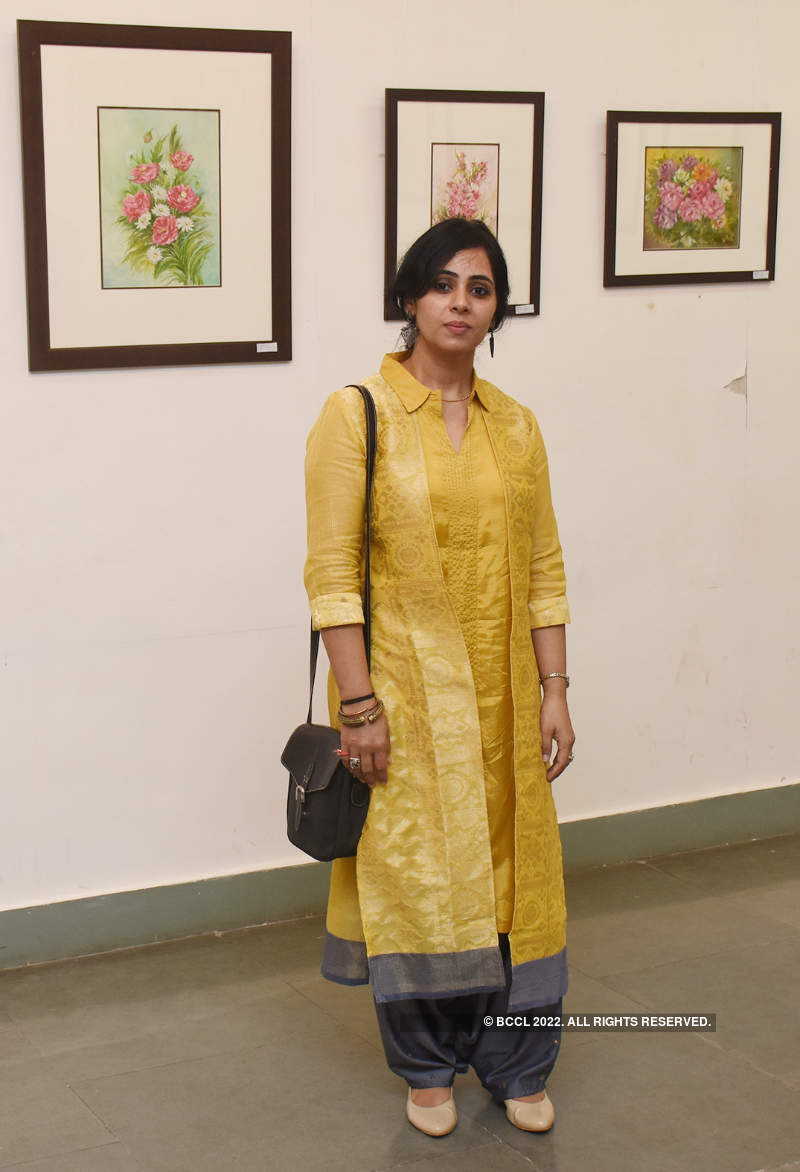Art lovers attend a flowery show at Lalit Kala Akademi