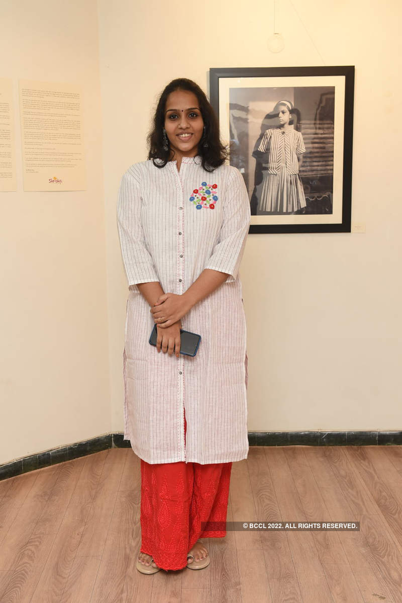 Socialites attend photo exhibition
