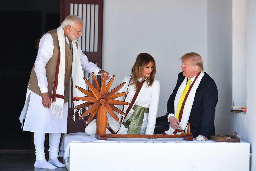Donald Trump tries his hand at charkha at Sabarmati Ashram