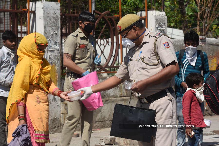 In pics: Food distributed to needy people amid coronavirus lockdown