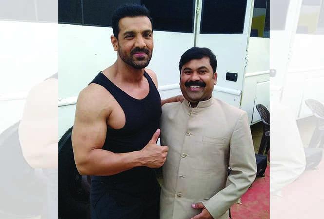 Sandeep Yaadav (R) with John Abraham, while shooting for Batla House in Lucknow (BCCL)