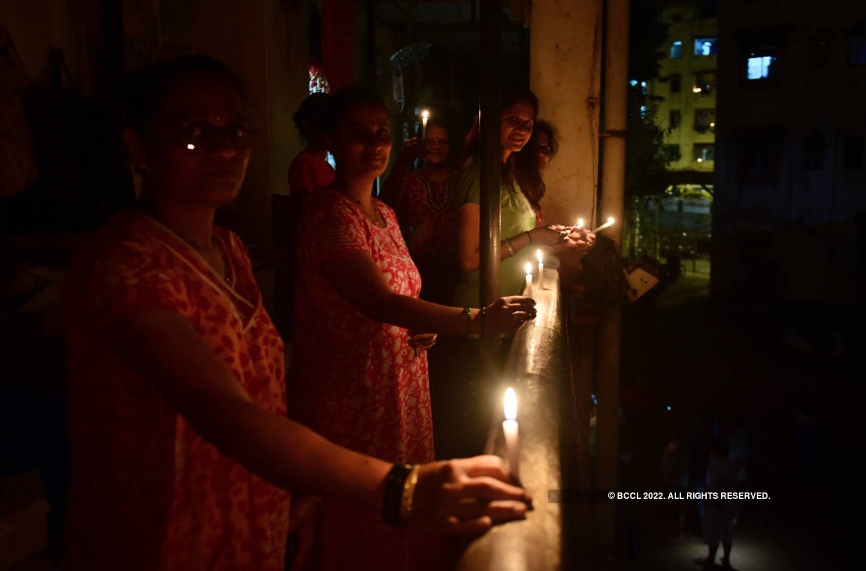 Mumbaikars stand in solidarity with frontline workers by lighting diyas and candles