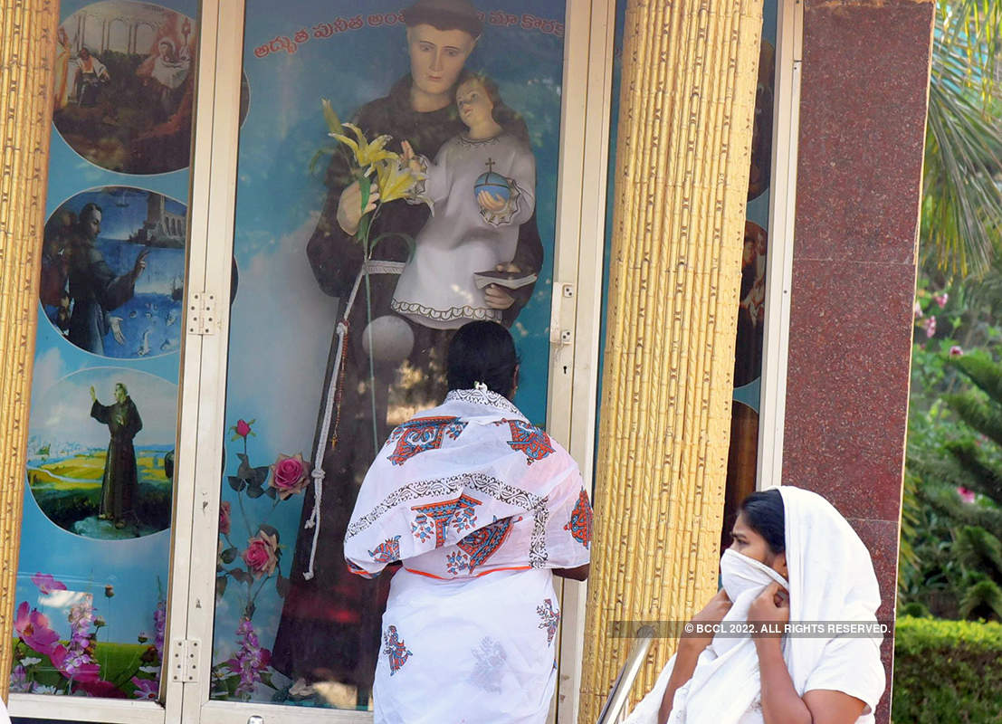 Pictures of sad devotees sitting outside closed churches amid Coronavirus lockdown
