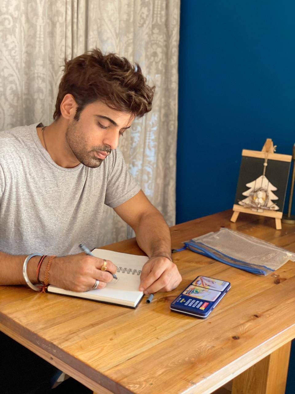 Mohit doing sketching at home