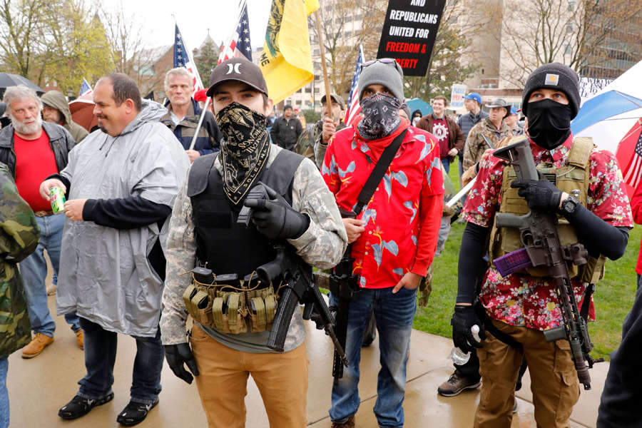 In pics: Armed protesters storm Michigan State House against COVID-19 lockdown