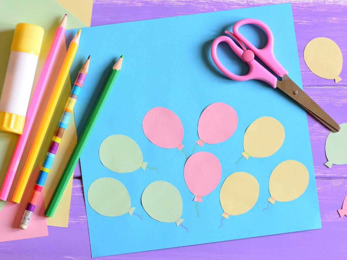 card-with-paper-air-balloons-scissors-glue-stick-colored-paper-on-a-picture-id678414422
