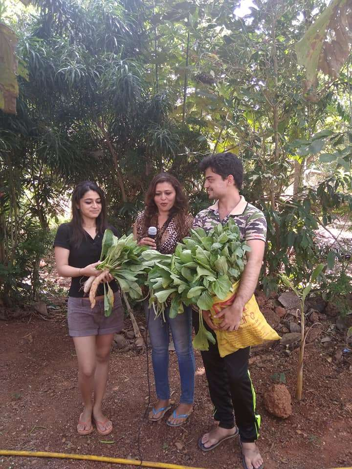 Maria Amaral with her kids Rachel and Louie harvested some veggies grown at home