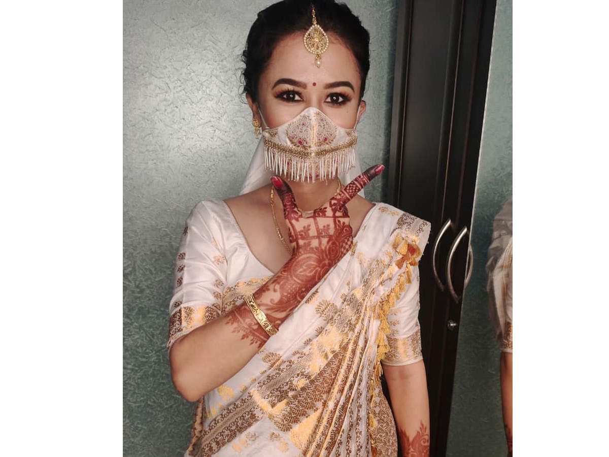 Pictures of the Assamese bride wearing a matching silk mask are going viral