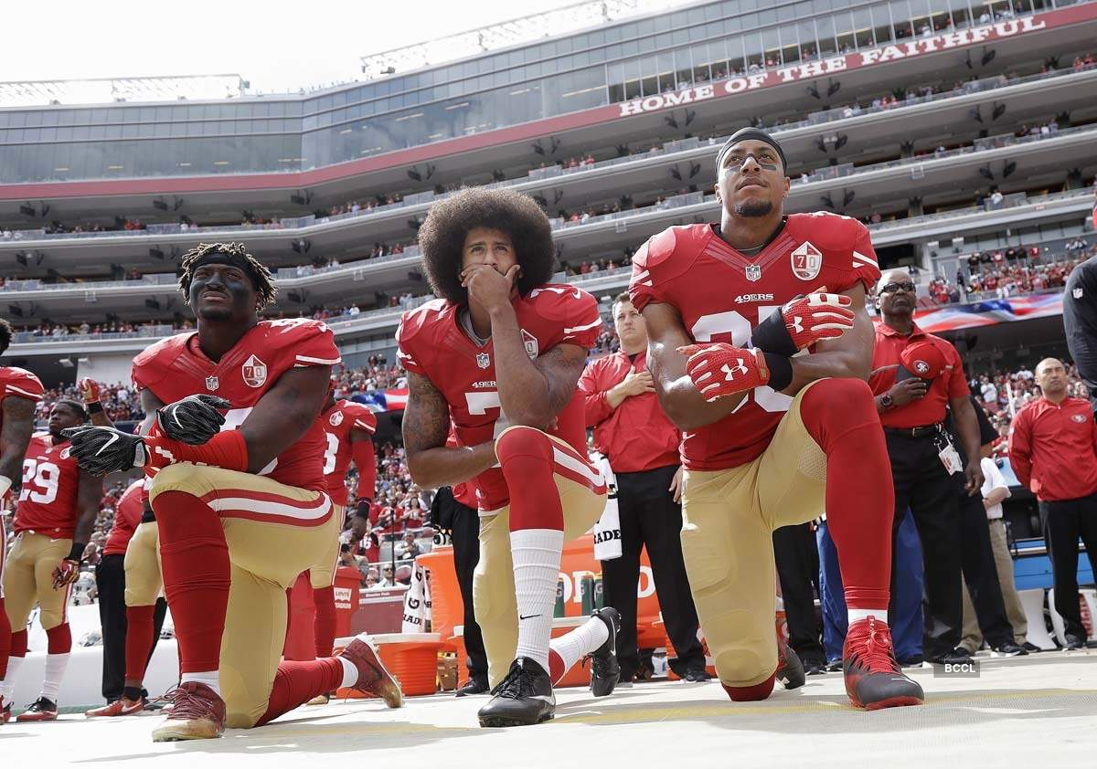Pictures of African American NFL star Colin Kaepernick, who protested against police brutality four years ago