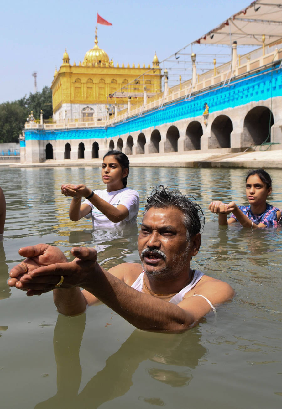 Solar eclipse: Devotees take holy dip in rivers