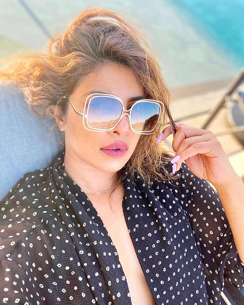 Priyanka Chopra is giving fans cool summer vibes with her new poolside selfie