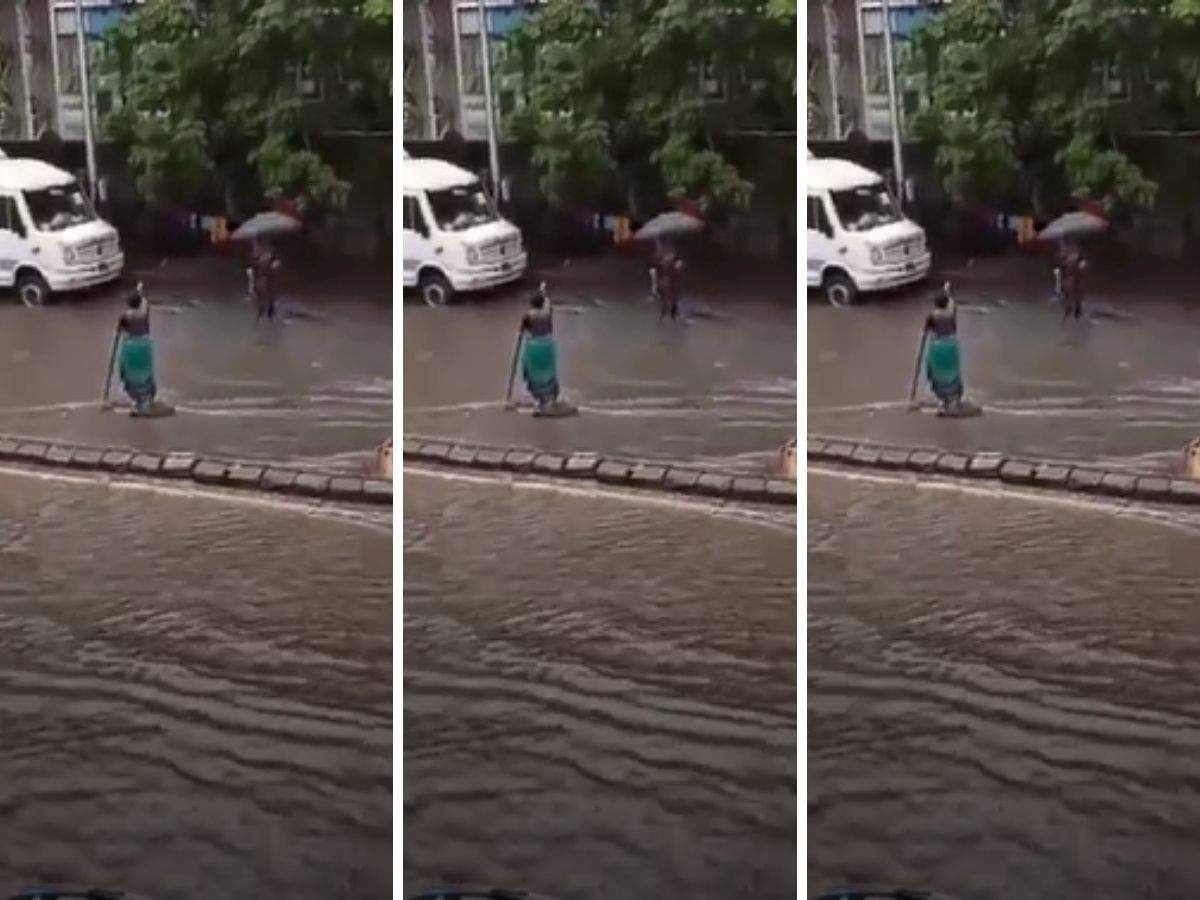 Woman stands in rain for seven hours to warn vehicles about open manhole, video viral