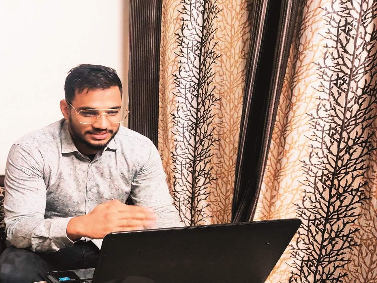 Mukesh Balan taking an online class of University students