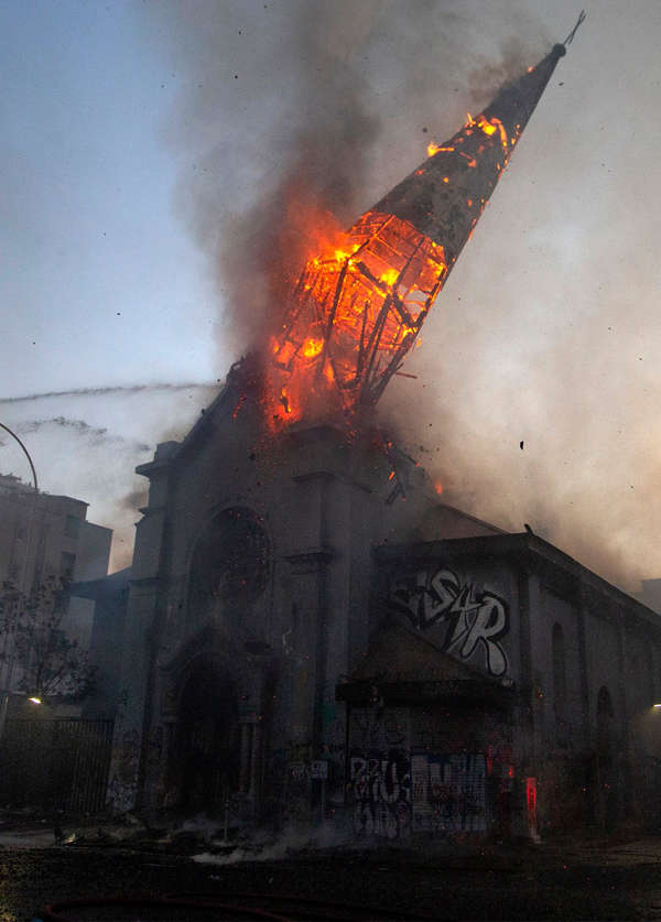 Two churches set ablaze as protests turn violent in Chile