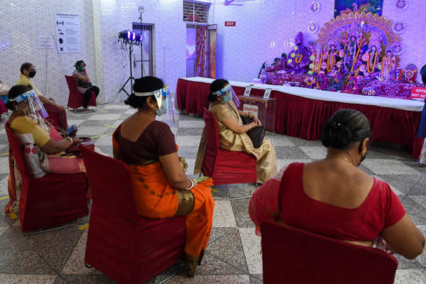 Devotees celebrate Durga Puja with COVID-19 safety protocols