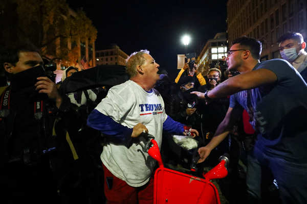 Clashes break out between Trump supporters and counter-protesters