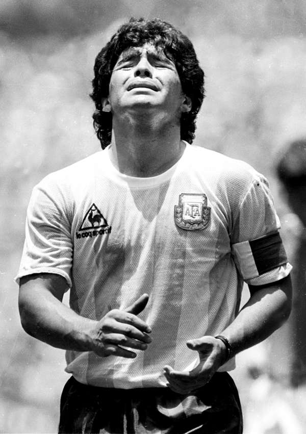 Argentina's Diego Maradona reacts to receiving a yellow card during first  half play in the World Cup final against Germany in Azteca Stadium in  Mexico City on June 29, 1986 - Photogallery