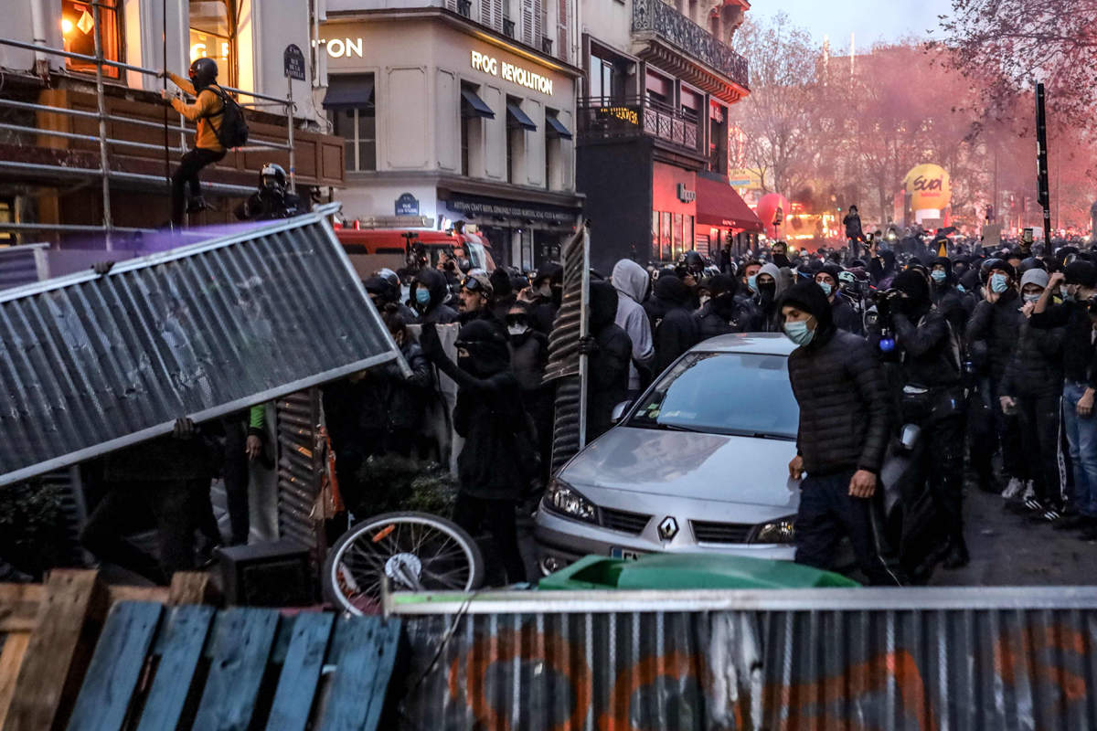 French protesters clash with police over proposed security law
