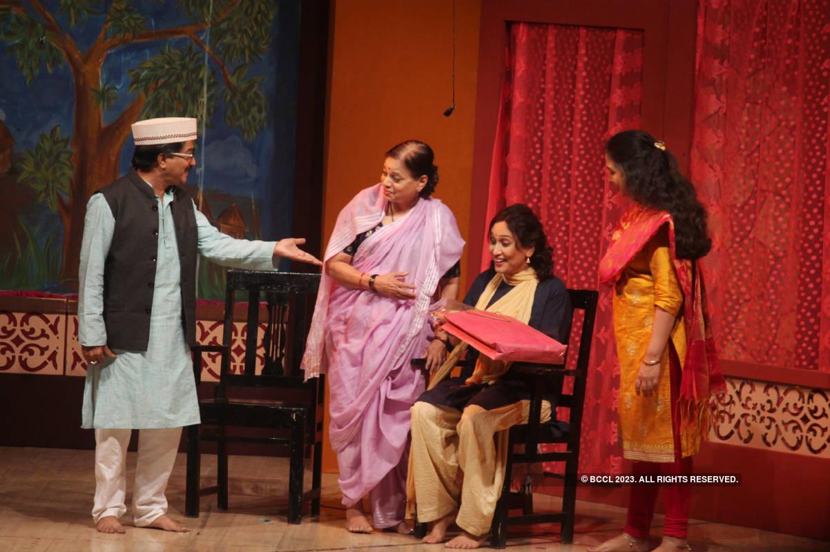 Nagpurians watch a play at an auditorium, after nine months