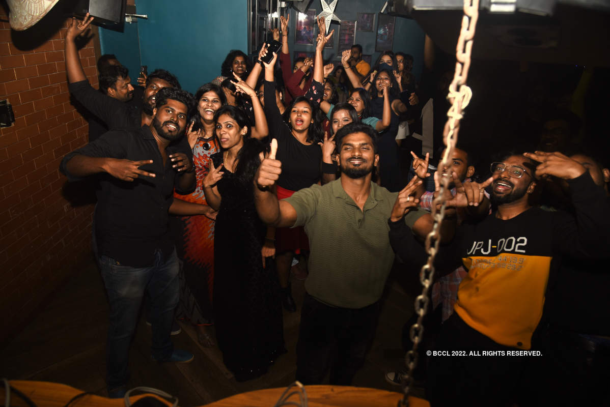 Revellers attend a party in the city