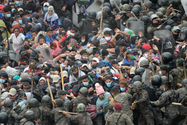 Guatemalan forces clash with US-bound migrant caravan