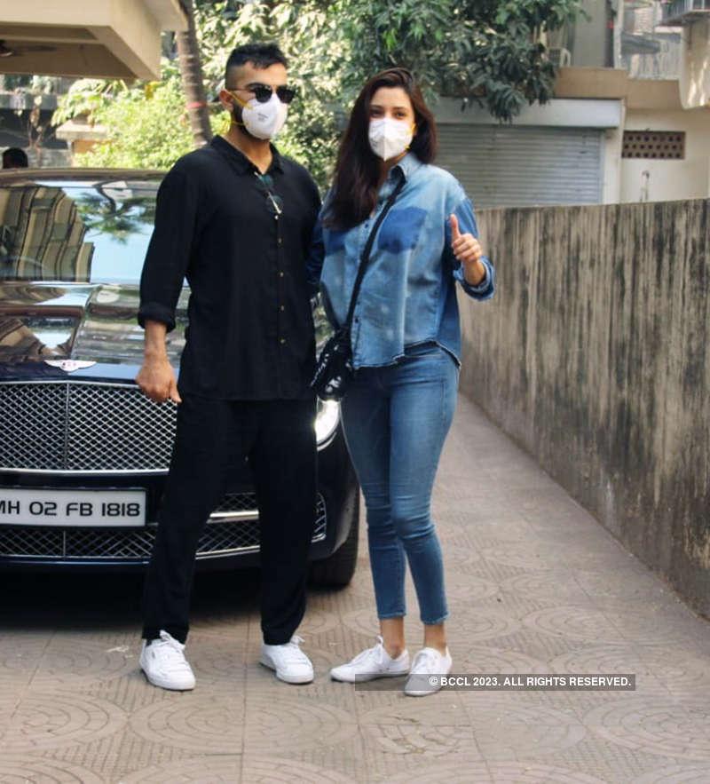 Pictures of Anushka Sharma holding little Vamika as she arrives in Mumbai with hubby Virat Kohli go viral