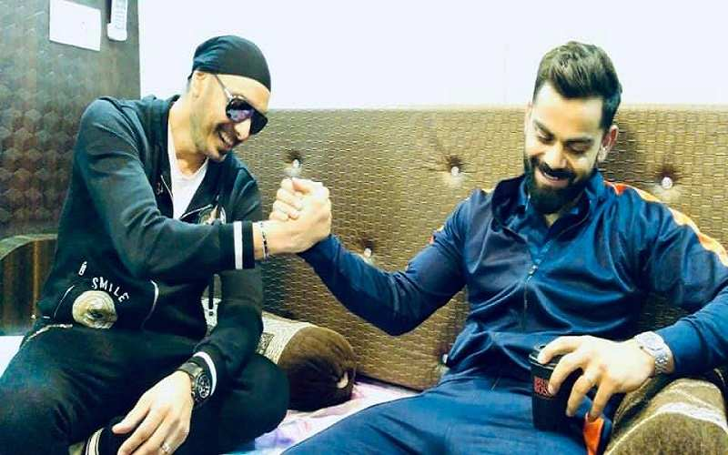 Sukhbir with cricketer Virat Kohli