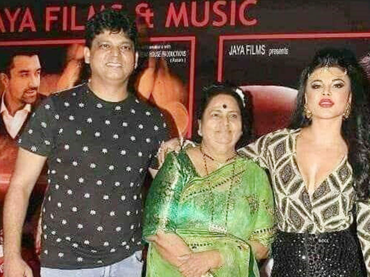 Rakhi Sawant and (left) with brother Rakesh and mother Jaya