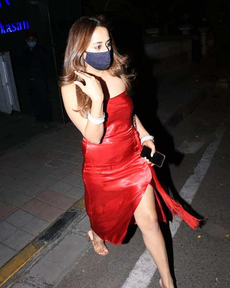 Newly-wed Natasha Dalal is making heads turn in a thigh-high slit dress on dinner outing