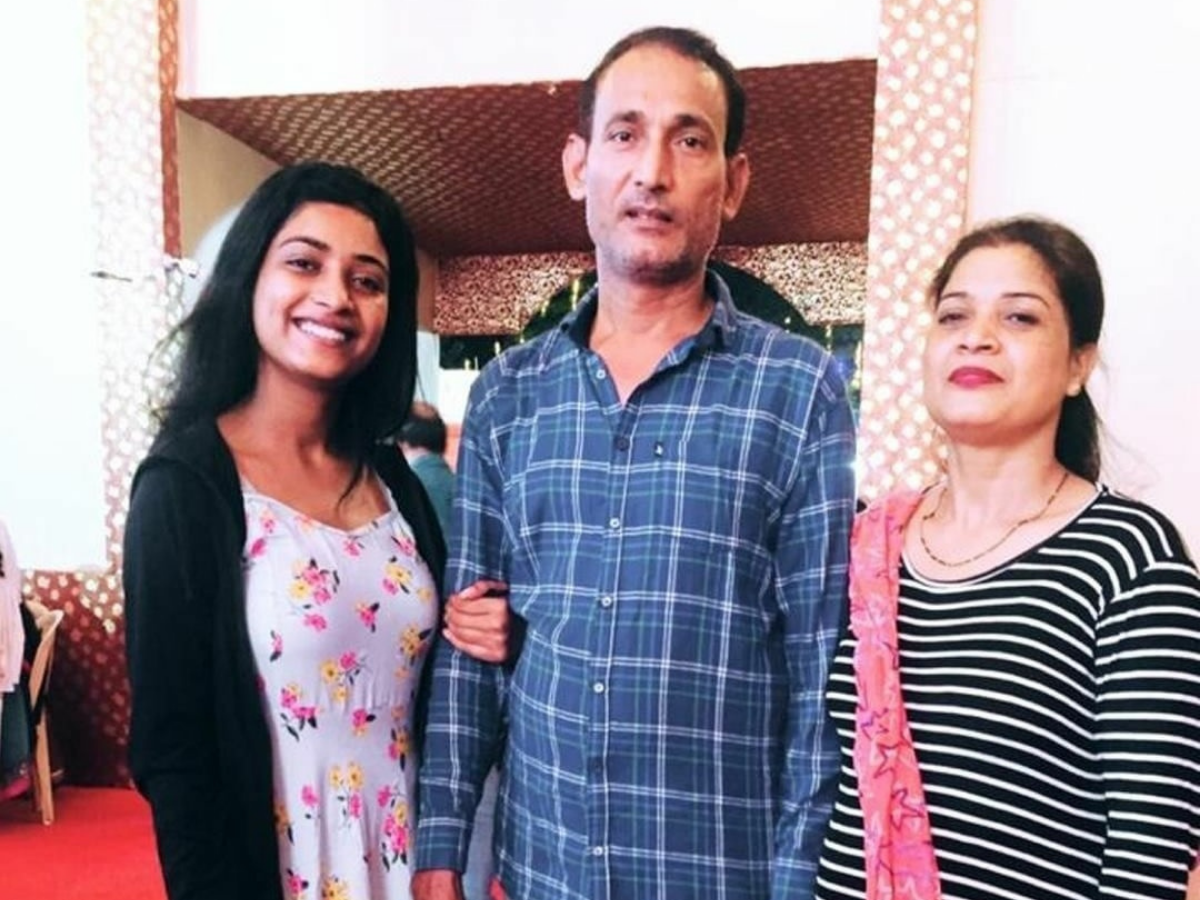 Manya Singh and her parents